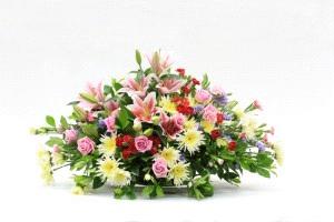 Cuscino funebre con gigli, rose e gerbere